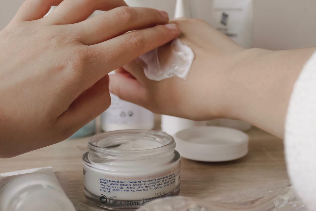 Person applying lotion to their hands
