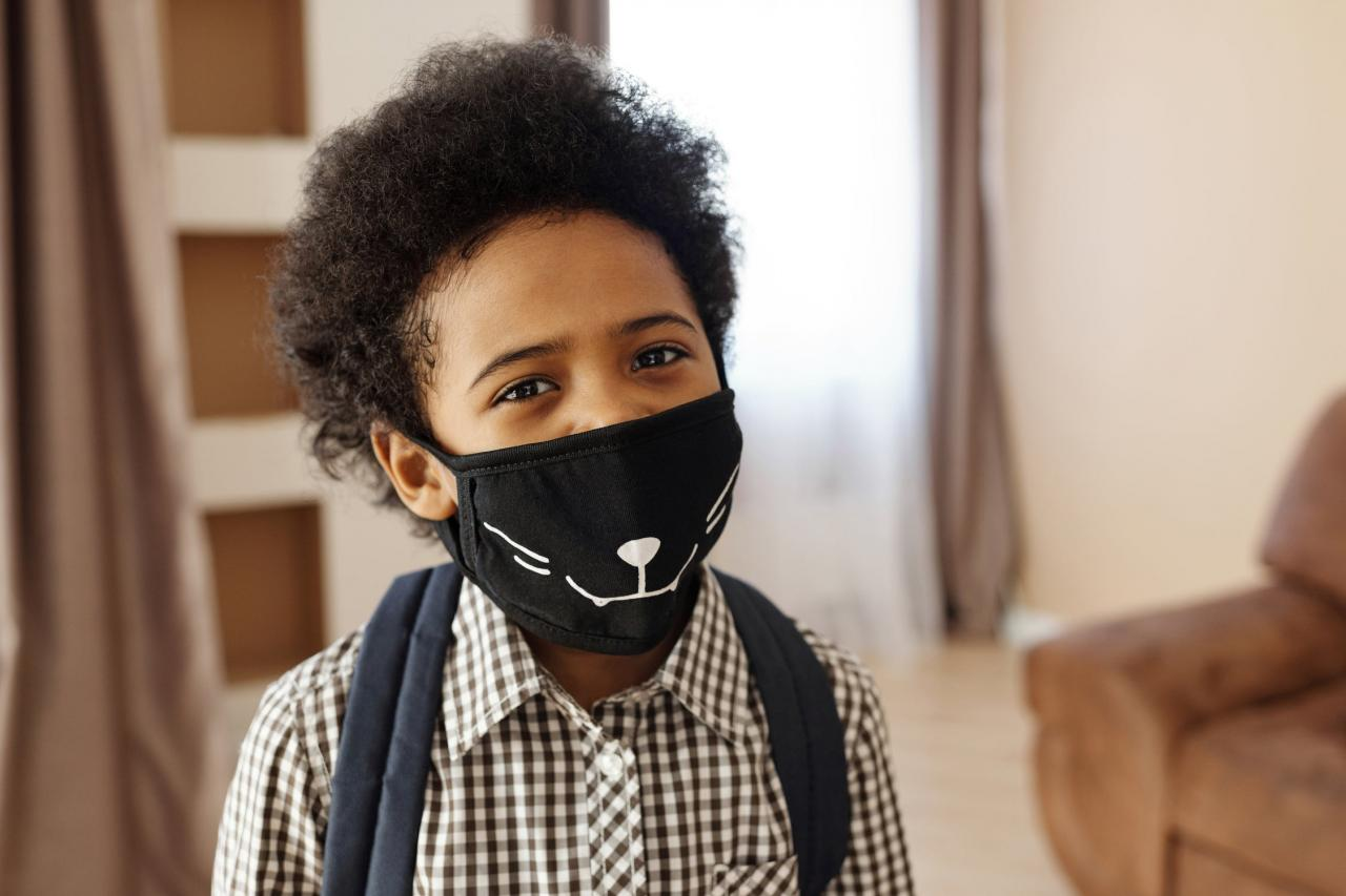 child wearing a mask