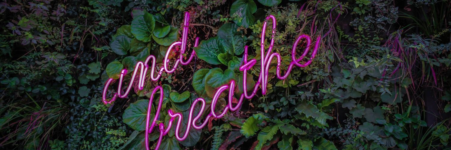 "neon lights that read, ""and breathe"""